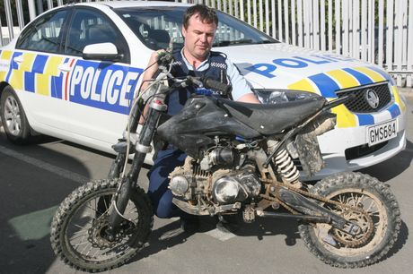 RECOVERED: Masterton police recovered this 125cc Lifan Pit Bike after the owner tackled the alleged thief, losing his middle finger and a tooth in the process. Pictured is Constable Rob Hutton.