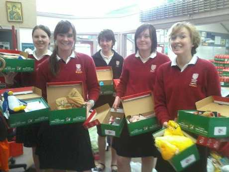 John Paul College senior students (from left) Lea-Renee Iddles, Grace Ward, Connor Gullet, Kristy Boardman and Georgia Collier-Carrington give up their lunchtime break to help fill Christmas presents for children overseas.