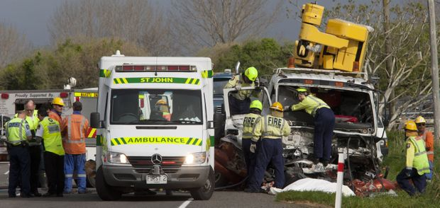 Emergency services attend to a person trapped after a head-on crash on on SH2.