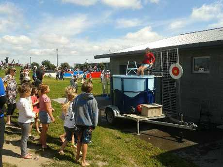 Hundreds of people enjoyed the games and activities at Arataki Community Day yesterday, including the dunking machine.