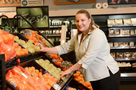 Breanne Ashcroft (PICTURED) is working at Maleny Woolworths with the help of Woolworths manager Matthew Brown and Donna Bailey from STEPS. Photo:Warren Lynam / Sunshine Coast Daily