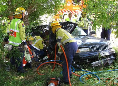 TRAPPED: Firefighters work to free an injured driver after a crash near Pakaraka Junction.