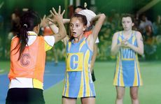 Junior State Championships (indoor netball) at Ipswich Indoor Sports Centre, Ipswich Showgrounds. Fever Ipswich (12 years) player, playing against Stingers BP.