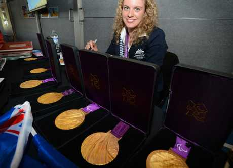 Paralympian Swimmer Jacqueline Freney pictured with her medals, signing autographs last year.