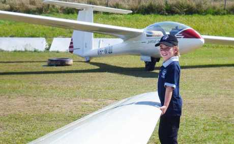 Natural in a plane, Lydia Stewart, helps move a glider at the Air League cadets camp at Gympie Airfield.
