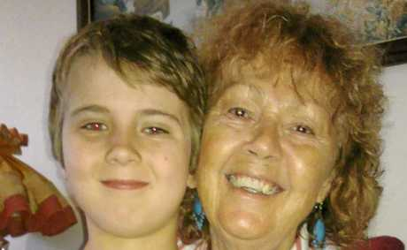 COINCIDENCE...? Marlene Lester, from Ballina, with her grandson Jackson and the statue of Saint Mary MacKillop gifted to them by a stranger.
