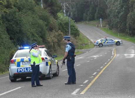 ROAD BLOCK: Armed police were called to the normally tranquil Kapiro Rd north of Kerikeri.