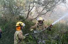 Fire fighters are have the large bush fire that was threatening houses under control.