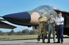 (From left) Group captains Mike Smith, Geoff Harland and John Ward inspect one of the newly renovated F-111s.