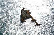 What is left of the stricken ship Rena on the Astrolabe Reef off the coast of Tauranga.