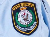 ONE teenager remained in hospital on Monday night and another was being questioned by police following a schoolyard stabbing in southern New South Wales.
