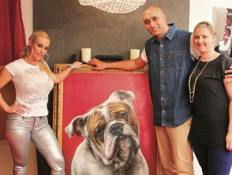 Tauranga man Mr G (Graham Hoete) and his wife Melissa present Coco, the glamour model wife of former rapper Ice T, a portrait of the famous couple's English bulldog Spartacus.