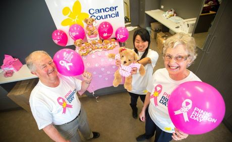 Promoting Pink Ribbon Day for the Cancer council are (from left) volunteers Barry Blamire, Lilly Li and Jennifer Lock. Photo: Trevor Veale/The Coffs Coast Advocate