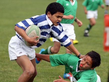 Hastings West's Atalino Kepu fends off Wairoa's Kaihau Pasikala on the way to the tryline during yesterday's 74-0 Wakely Shield win at Taradale.  Photo / Paul Taylor