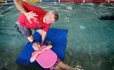 The Laurie Lawrence Swim School has moved to Aqualogan Springwood, pictured with Tiegan Duncan, 4. Photo: Inga Williams / The Reporter