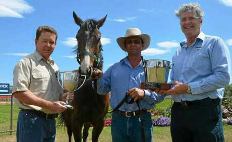 Warwick Vet Clinic's Chris Reardon, five-year-old thoroughbred Banderin, trainers assistant Steve Clarke and My Optical's Paul Morrissey are ready to kick off the Calcutta this Friday night.