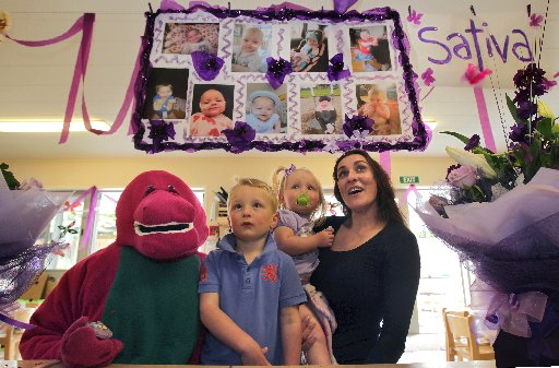 Top Kids goes purple to raise awareness and to celebrate Sativas life. Sativas sister Indee and brother Bailey celebrate with Barney and Rachel Blyelvens.