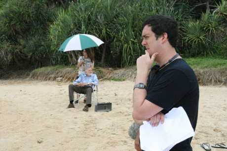 Daley Pearson and Barry Crocker filming at Coolum Beach. Photo: Contributed