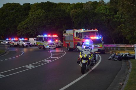 SAD LOSS: Emergency services attend the scene of a crash which killed popular local Matthew Dean Eaton.