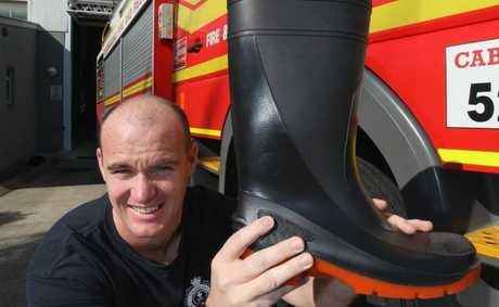 Caboolture fire fighter, Lynton Flanagan is participating in Fill The Boot. Proceeds go to the Muscular Dystophy Foundation. Donate at www.filltheboot.com.au. Photo Darryn Smith / Caboolture News