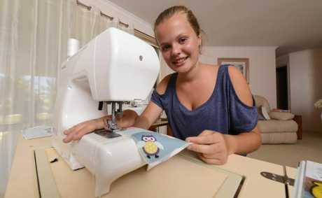 Caitlin Creber, 13,  preparing items for the Homemade Markets in Yamba. Photo: Adam Hourigan / The Daily Examiner