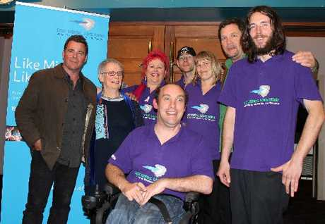 LIKE FOR LIKE: Roy Brown and Anne Helm, who featured in documentary Mental Notes, in Masterton with Like Minds, Like Mine team members Corrinne Oliver, Matt Wills, Greg Fowler, Julie Channer, Mental Notes director Jim Marbrook, and Daniel Real.