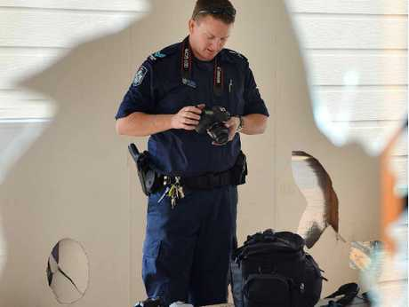 Senior Constable Chad Doak photographs the vandalism at Skill Centred.
