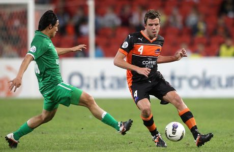 Matthew Jurman of the Roar takes on the defence during the AFC Asian Champions League match between the Brisbane Roar and Beijing Guoan.