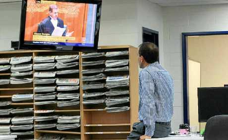 KEEN VIEWER: Mal Brough watches from the Daily's news room as Peter Slipper resigns.