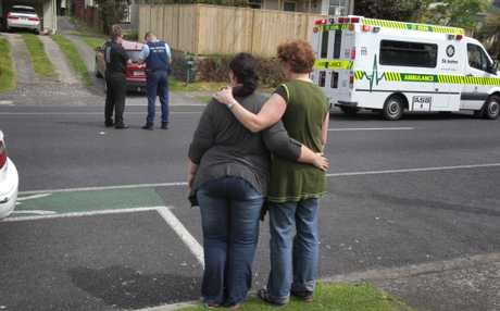 Windsor Rd residents comfort each other after and elderly pedestrian was struck and killed.