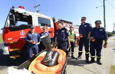 Maclean fire captain Darrell Shaw, Daniel Gray, Alwyn Eagleton, Paul Hyland, Darryl Bailey and Ken Crampton wheel a boot down the main street of Maclean as parft of a relay from Brisbane to Sydney to raise funds for muscular dystrophy. Photo Adam Hourigan / The Daily Examiner