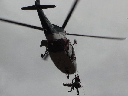 The injured forestry worker is winched aboard a chopper. Photo / Wally Mitchell