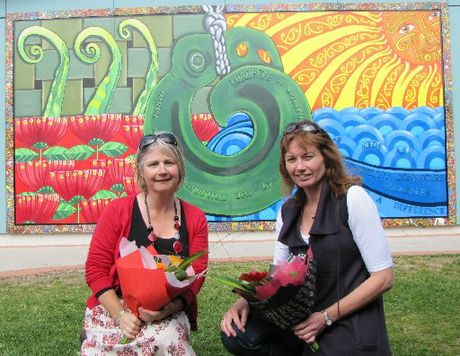 Artists Jackie Toohey and Andrea Van Klein with their colourful mural depicting elements uniquely Omokoroa.