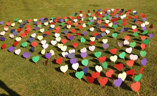 Heartfelt messages of support bloom at Queens Park.