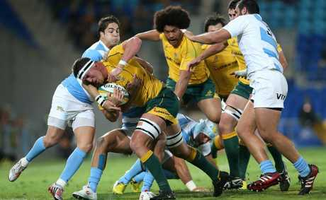 GOLD COAST, AUSTRALIA - SEPTEMBER 15: Kane Douglas of the Australian Wallabies is tackled during the Rugby Championship match between the Australian Wallabies and Argentina at Skilled Park on September 15, 2012 on the Gold Coast, Australia. (Photo by Chris Hyde/Getty Images)