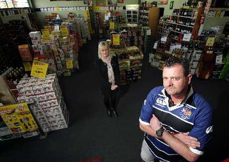OVERSUPPLY: John Sherwood of Mickey's Super Liquor and Jenny Murphy of Liquorland Wanganui say there are too many bottle shops in Wanganui.PHOTO/STUART MUNRO