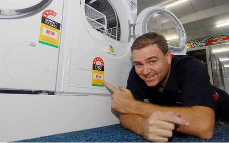 LOW ON ENERGY: Ron Bassan from Retravision with a energy saving washing machine and dryer.