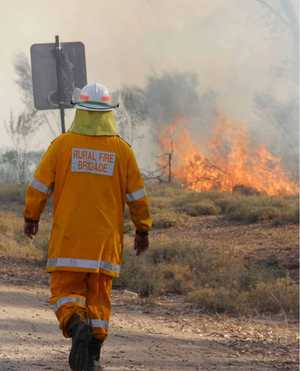 GEMFIELDS FIRE: Firies backburn to protect properties.