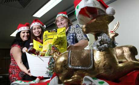Hope Dewar, Samilya Muller and Colleen Benson along with Logan community groups have once again begun collecting donations for their upcoming adopt-a-family Christmas program. Photo: Inga Williams / The Reporter