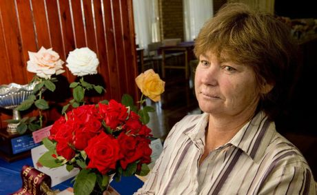 Sue Humphrey withe champion roses of the show. Darling Downs Spring Champion Rose Show . Photo Nev Madsen / The Chronicle