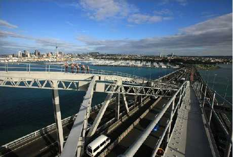 WHAT A SIGHT: Visitors climb to the top of Auckland Harbour Bridge for the windiest view of the city and Waitemata Harbour.