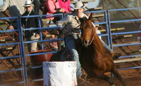 TAKING ON HER RUN: Kingaroy's Kate Benedict charges through her barrel race at the Kumbia Rodeo. Photo: Aiden Burgess