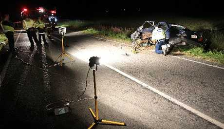 AFTERMATH: Police at the crash scene on Racecourse Rd on Thursday night.