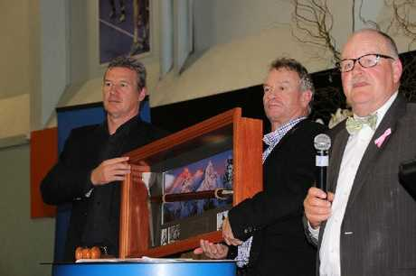 SOLD: Sir John Kirwan and Grant Fox hold on to a framed limited-edition Sir Edmund Hillary ice axe that went under the hammer for $3900 for Project Promise.