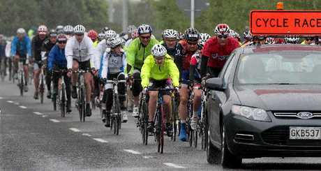 PEDALS DOWN: Rain and cold didn't deter these riders in the Tour of the Bay. PHOTO/WARREN BUCKLAND HBT124126-09