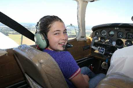 FREE AS A BIRD: Unya Roberts is all smiles as she soars above Canterbury during a school holiday flight