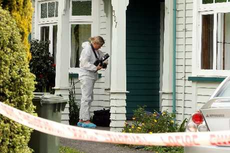 SCOURING THE SCENE: Police and forensic staff investigate a fatal stabbing at a house notorious for partying on King St South, Hastings. PHOTO/PAUL TAYLOR HBT124123-06