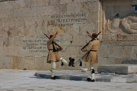 CLASSICS: Evzones guard the Tomb of the Unknown Soldier; caryatids, architectural sculptures, at the Acropolis.