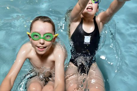 Joseph Butta, 10, and Amelia Schossow, 7, work on their swimming ahead of the Tuff Kids Triathlon. 