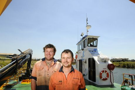 Harwood Marine's apprentice marine mechanic Trent Carr and marine mechanic Sean Waite at the front of one of the boats built at Harwood Marine recently. Photo: JoJo Newby / The Daily Examiner